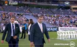 Socceroos coach Ange Postecoglou returned to his former club with the Asian Cup trophy before the Melbourne Derby.