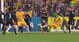 Mat Leckie fired home a late strike to help Australia to a thrilling 2-1 win over Thailand in Melbourne.
