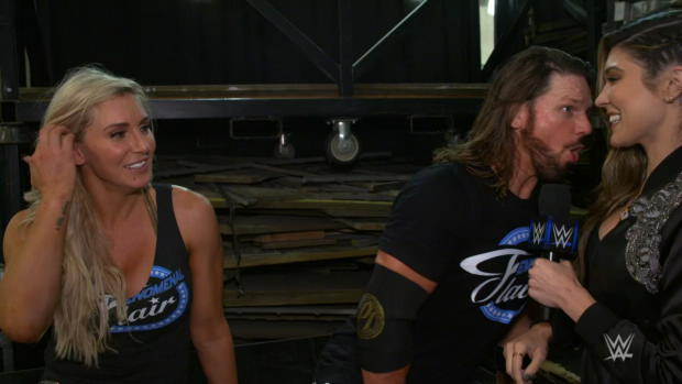 Charlotte Flair & AJ Styles engage in a post-match Woo-off