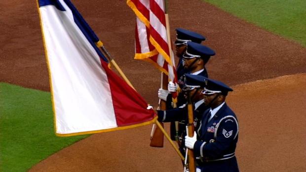 Walker sings the national anthem