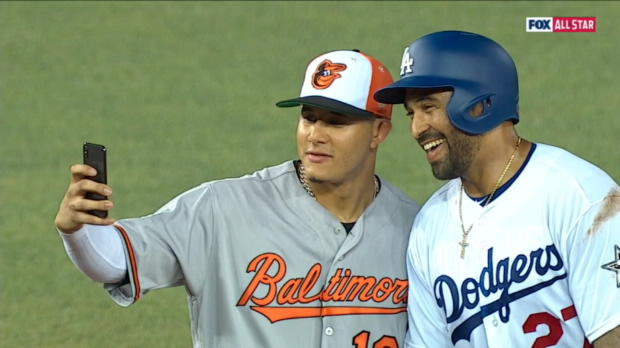 Players take selfies during ASG