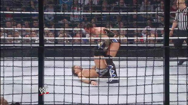 Chris Jericho slams CM Punk into an Elimination Chamber pod: WWE Elimination Chamber 2012