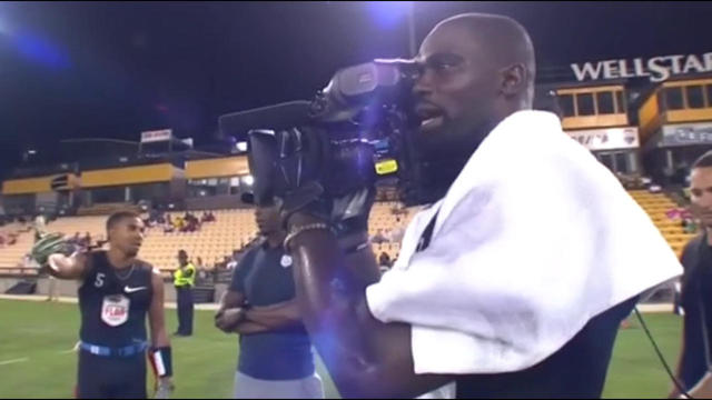 Former NFL defensive back James Ihedigbo takes control of the camera during American Flag Football League game