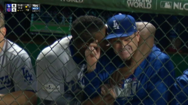 Puig embraces Ward in dugout