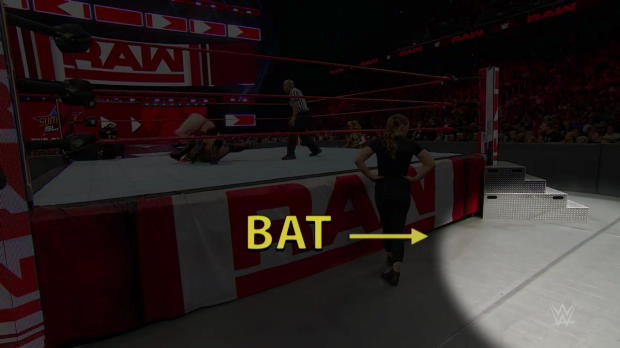 Ronda Rousey meets a bat at ringside during Raw