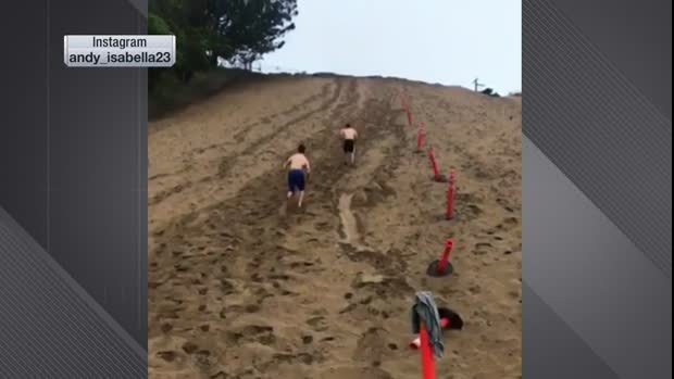 Arizona Cardinals wide receiver Andy Isabella works out by running up a sand dune