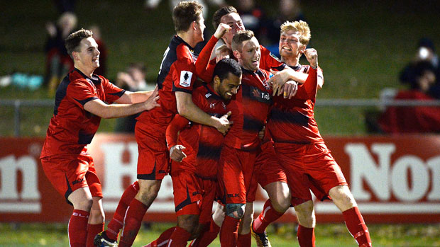 Redlands players celebrate their incredible win over Hyundai A-League champions Adelaide United.