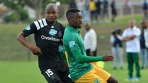 Thabo Qalinge of Orlando Pirates challenges Zolani Nkombelo of Golden Arrows