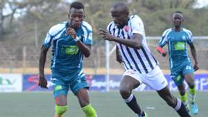 Moses Arita (R) contests for the ball with KCB's Chrispinus Onyango
