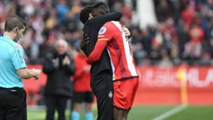 Michael Olunga celebrates with the Girona FC coach.