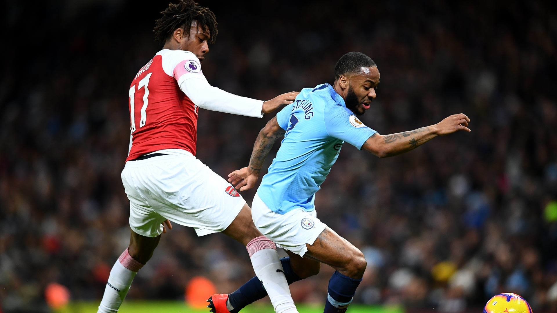 Alex Iwobi of Arsenal, Manchester City's Raheem Sterling