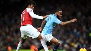 Alex Iwobi of Arsenal, Manchester City's Raheem Sterling
