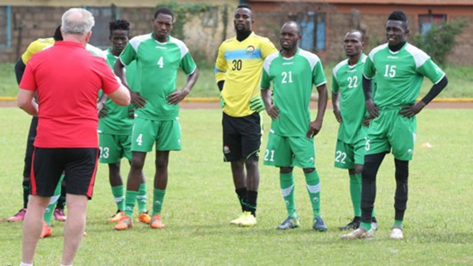Harambee Stars coach Paul Put with players