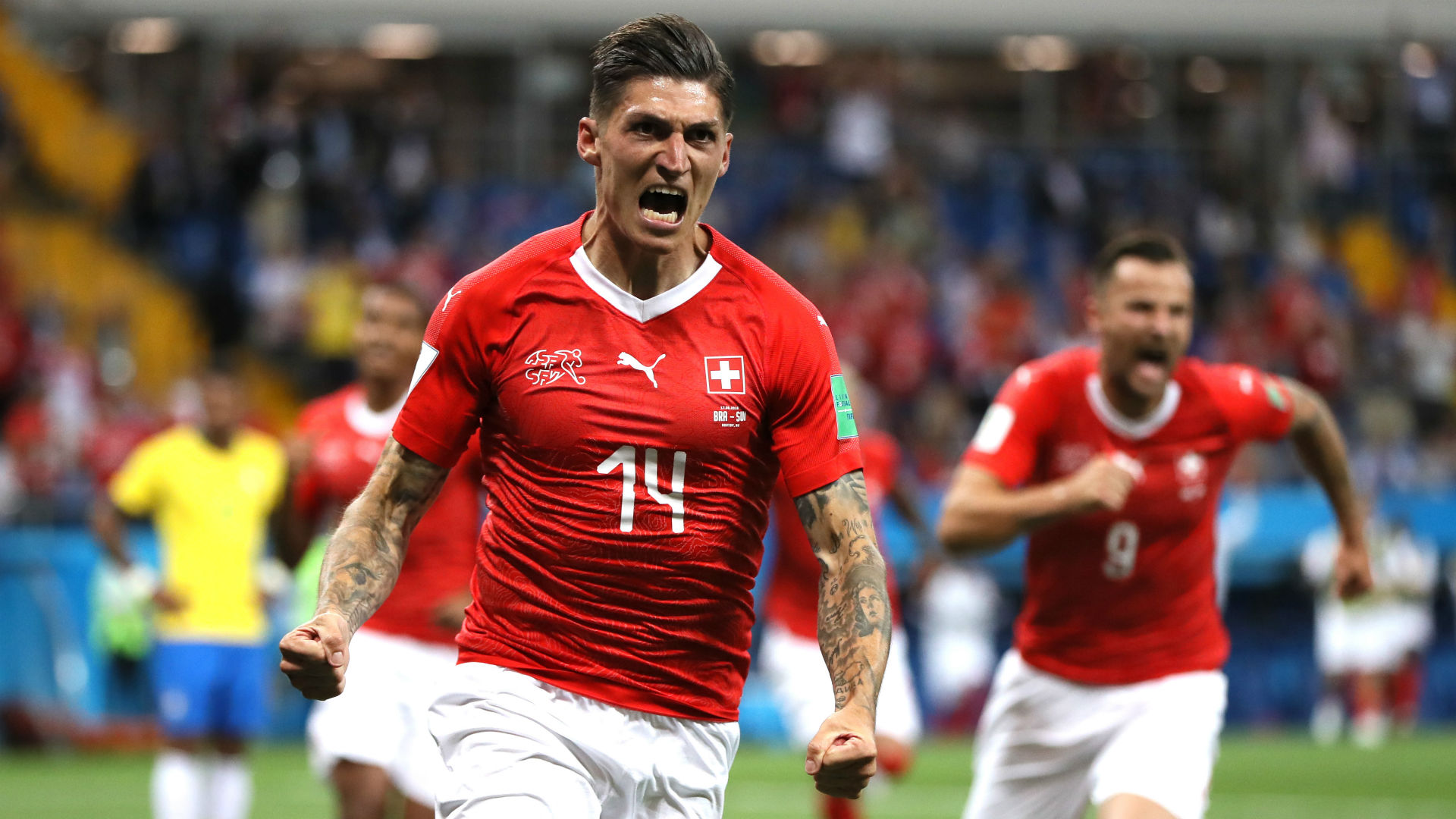 Switzerland strike late to sink Serbia 2-1