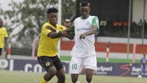 Gor Mahia midiflder Kenneth Muguna fight for the ball with Tusker's Hashim Sempala.
