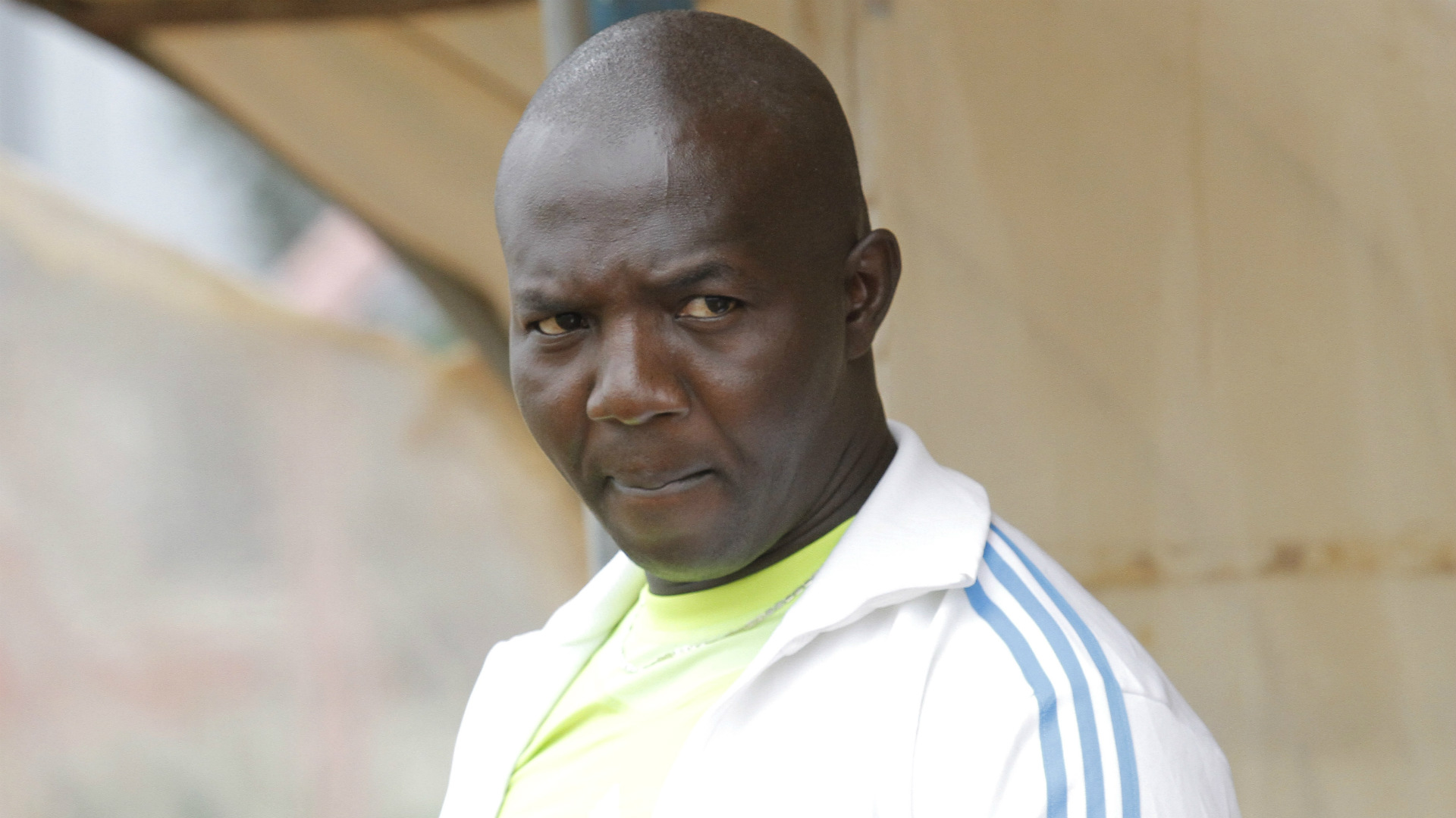 Kakamega Homeboyz coach Mike Mururi follows proceedings at Afraha Stadium in Nakuru.