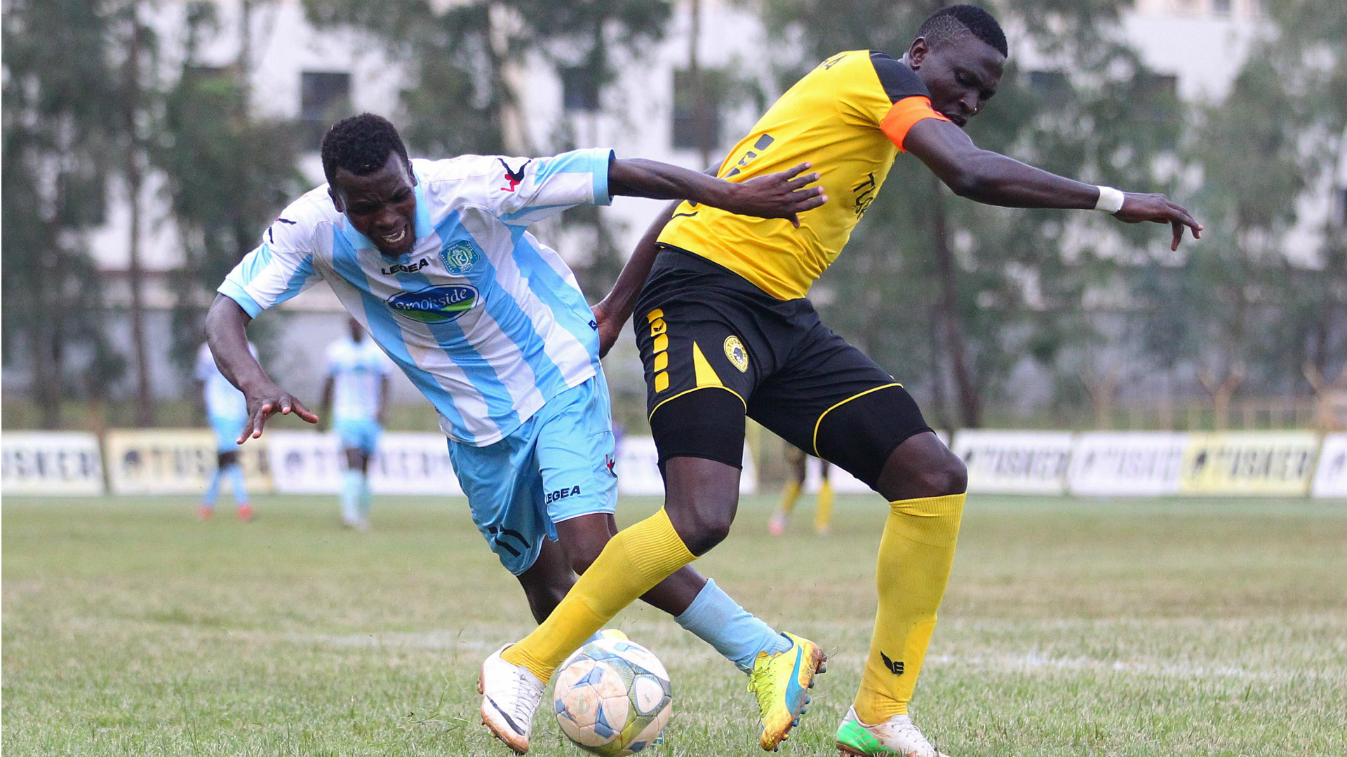 Hansel Ochieng of Thika United and Lawrence Kasadha of Tusker.