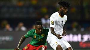 Cameroon's midfielder Georges Mandjeck vies for the ball with Ghana's midfielder Thomas Partey during the 2019 Africa Cup of Nations