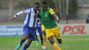 Divine Lunga of Golden Arrows is challenged by Bandile Shandu of Maritzburg United, August 2018