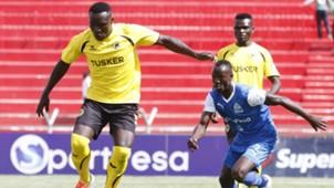 Tusker midfielder Collins Shivachi outpace Godfrey Walusimbi.