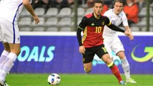 Belgium's midfielder Eden Hazard runs with the ball during a Friendly match against Finland
