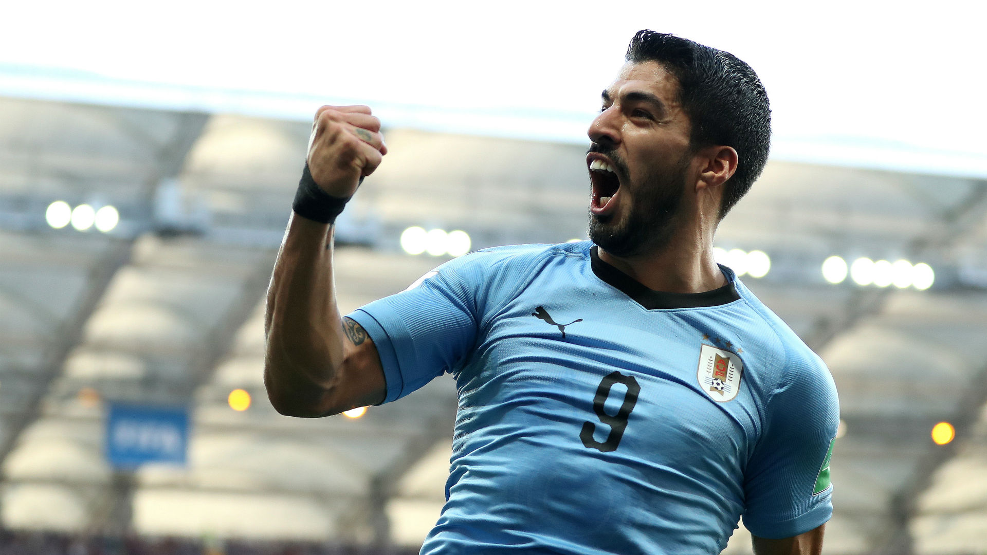 Suarez inspires Uruguay to win over 10-man Russia