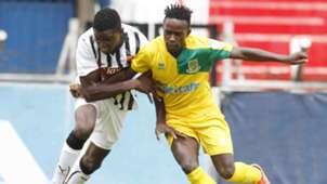 Joseph Imbenzi tackles Chrispinus Oduor of Mathare United.