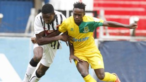 Joseph Imbenzi tackles Chrispinus Oduor of Mathare United.