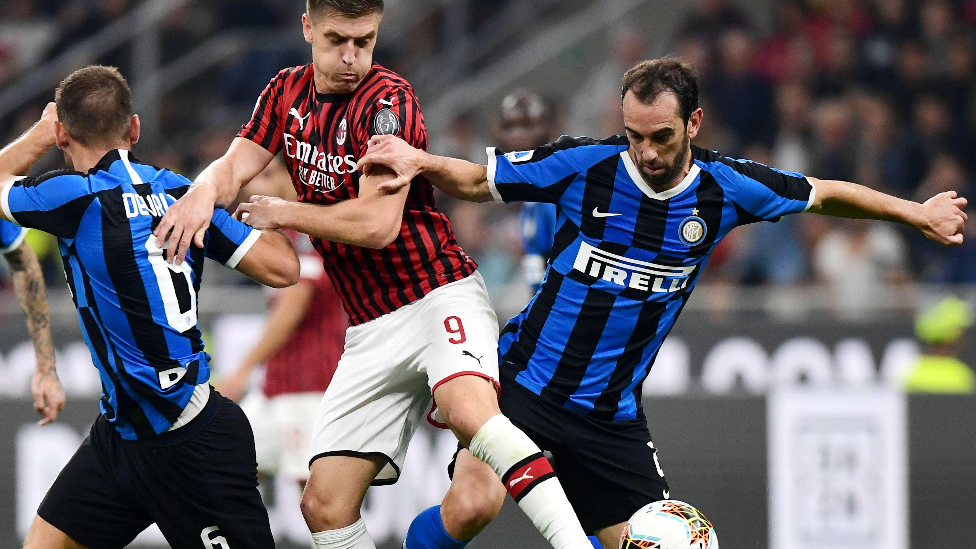 Krzyzstof Piatek Diego Godin Milan-Inter