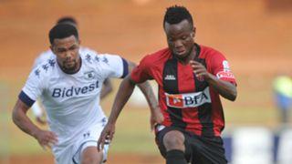 Granwald Scott of Bidvest Wits challenges Akinfenwa Ibukun of Club Desportivo de Agosto