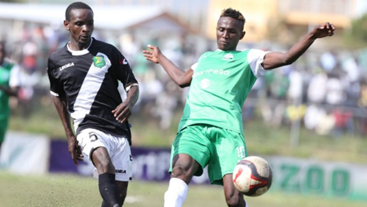 Michael Madoya of Zoo Kericho tackle Kenneth Muguna of Gor Mahia
