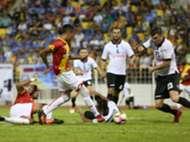 Selangor's Adam Nor Azlin (in red, standing) scores against Pulau Pinang 21/1/2017