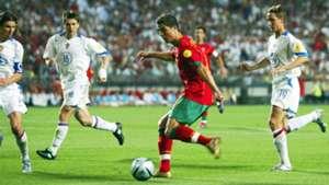 Cristiano Ronaldo taking on Russian defenders in Euro 2004
