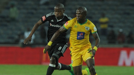 Mxolisi Kunene of Baroka is challenged by Thabo Matlaba of Orlando Pirates