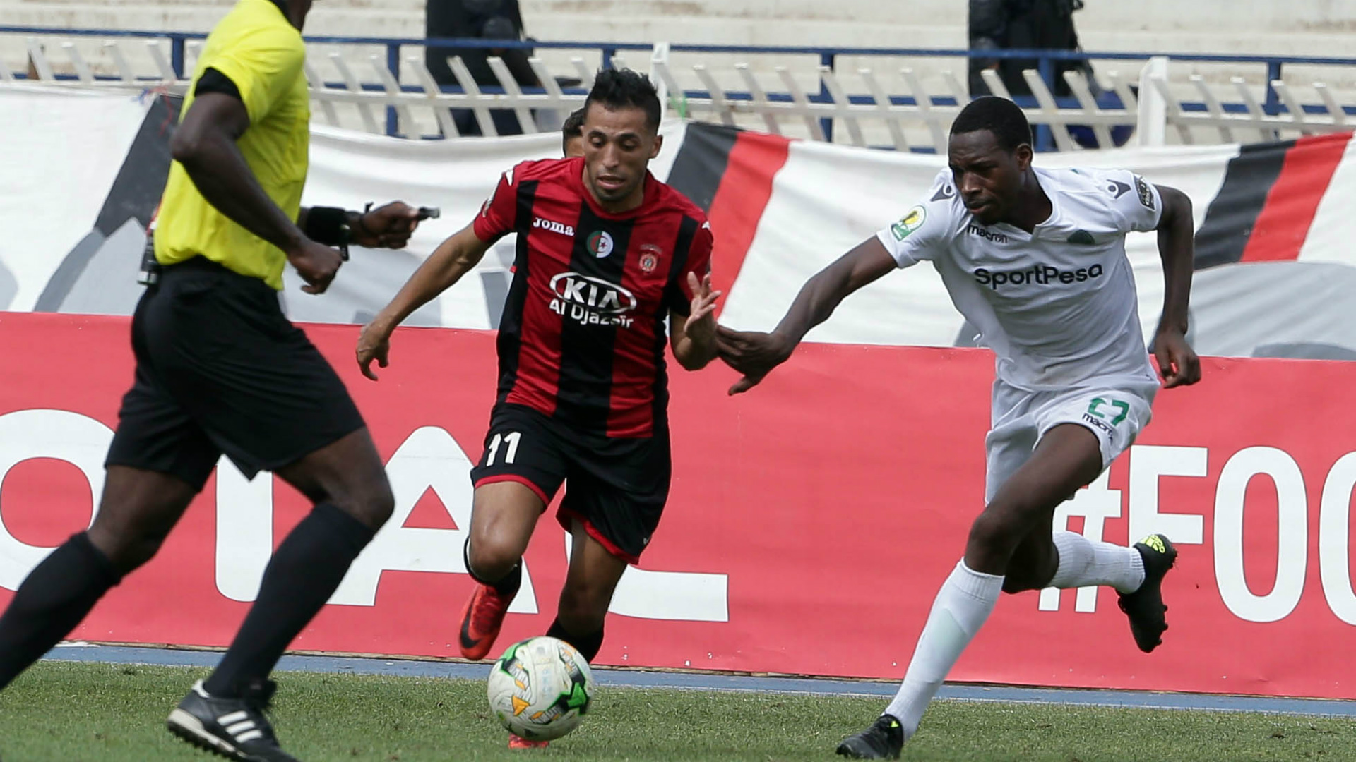 USM Alger player Abderrahmane Meziane (L) and Gor Mahia FC player Charles Momanyi.
