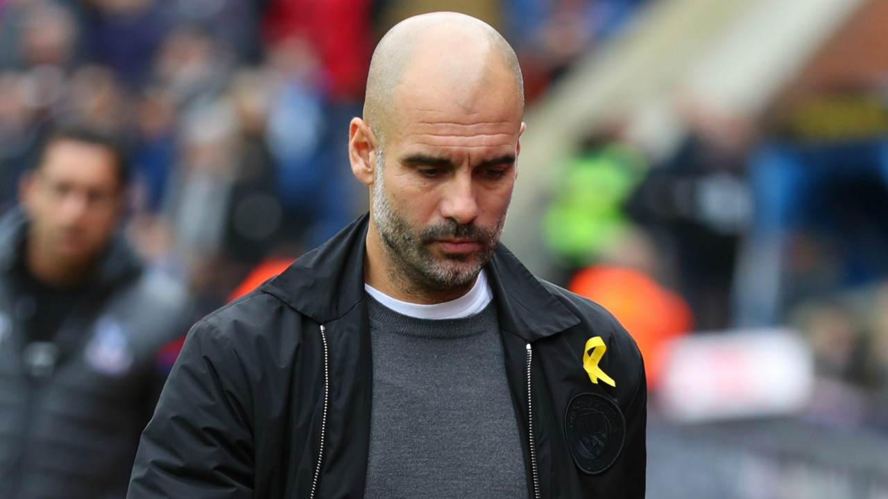 Why Does Pep Guardiola Wear A Yellow Ribbon The Meaning Behind Man