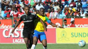 Gift Motupa of Orlando Pirates is challenged by Hlompho Kekana of Mamelodi Sundowns
