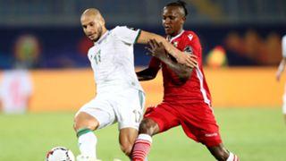 Adlane Guedioura of Algeria challenged by Francis Kahata of Kenya.