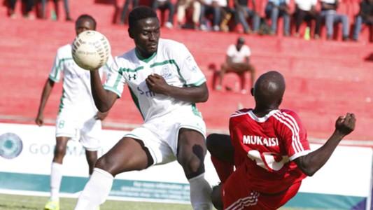 Dennis Mukaisi tackle Musa Mohammed.
