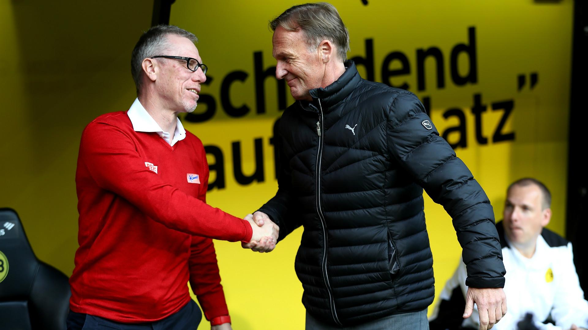 Peter Stoger Hans Joachim Watzke Borussia Dortmund