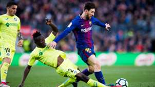 Djene Dakonam of Getafe, and Barcelona's Lionel Messi