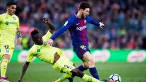 Djene Dakonam of Getafe, and Barcelona's Lionel Messi