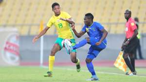 Jamie Webber of South Africa challenged by Yahya Ramadhani of Tanzania
