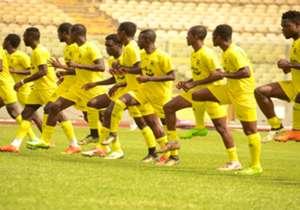 Kotoko players jogging across the pitch at the Baba Yara Sports Stadium