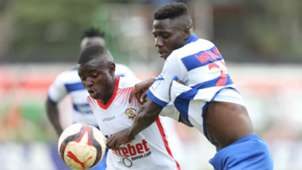 Mark Bikokwa (L) of Ulinzi Stars tackled by Lewis Wanamia of AFC Leopards.