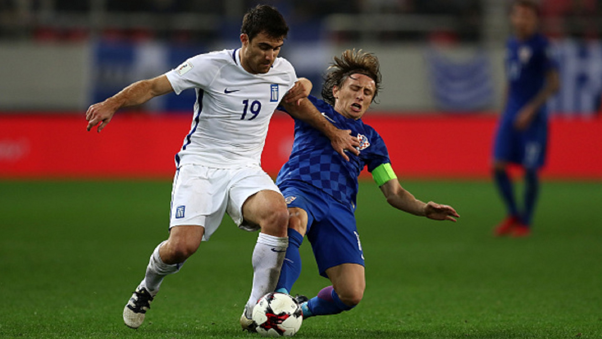 Sokratis Papastathopoulos of Greece and Luka Modric of Croatia during the FIFA 2018 World Cup Qualifier Play-Off