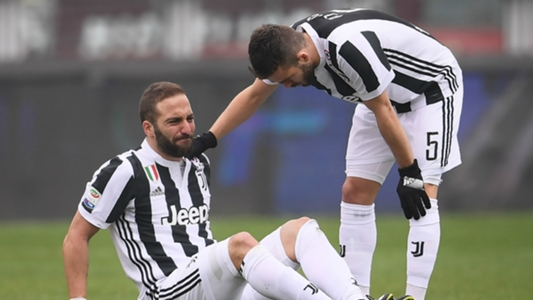 Higuain limps off injured after colliding with Torino goalkeeper
