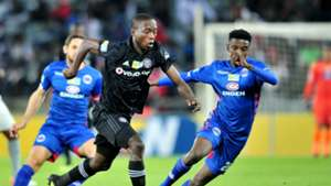 Ben Motshwari of Orlando Pirates challenged by Tebogo Mokoena of Supersport United, August 2018