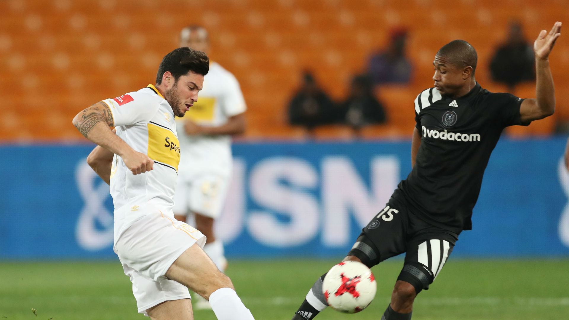 Roland Putsche of Cape Town City tackles Thabo Qalinge of Orlando Pirates