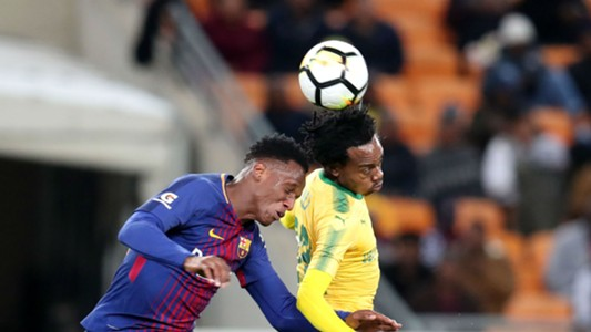 Yerry Mina of Barcelona and Percy Tau of Mamelodi Sundowns - May 16 2018
